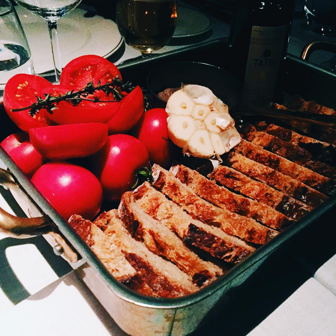 One of the typical Spanish dishes: bread, tomato, garlic, olive oil, salt and friends || @tatelmadrid ||